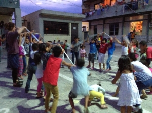 Lorene dances with the children of Lavrio Refugee Camp